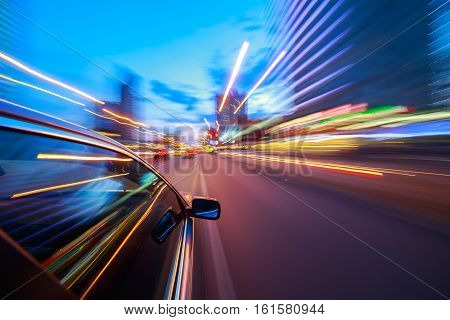 View from Side of Car moving in a night city, Blurred Motion