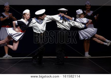 ST. PETERSBURG, RUSSIA - OCTOBER 28, 2016: Dancing group Surprise performing in festival-contest of vocal and choreographic art Autumn Transformation. More than 500 children take part in the contest