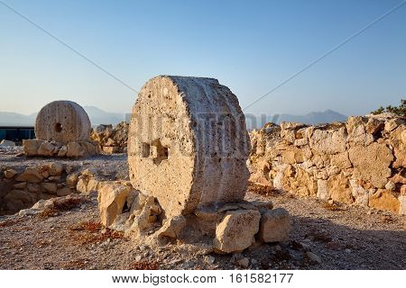 Old millstones on display in Alicante Santa Barbara castle