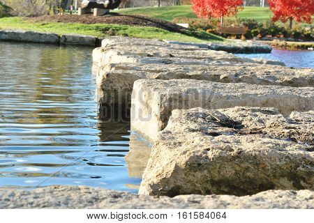 Stepping stones in Olathe Lake during Fall