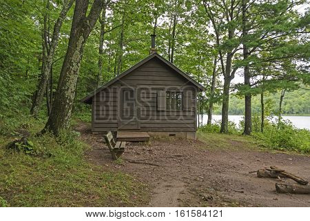 Primitive Cabin on a Forested Lakeshore on Lake of the Clouds in Porcupine Mountains State Park in Michigan