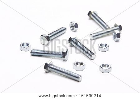 Few nuts and bolts on white background