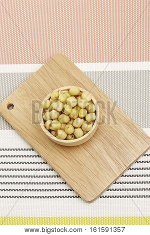 Dried lotus seeds on wooden background / Dried lotus seeds
