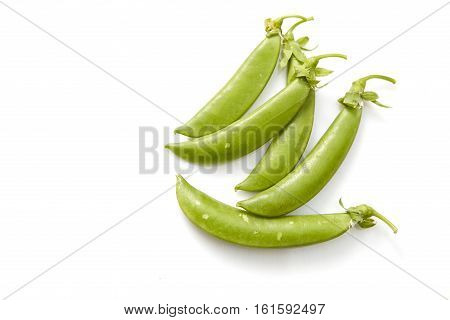 Snow peas isolated over white background,  salad, pods, unshelled,
