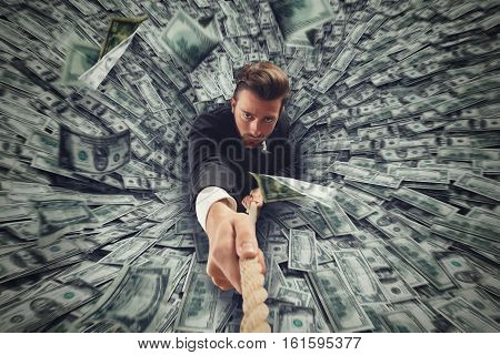 Businessman swallowed by black hole of money