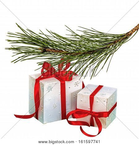 Gifts in boxes lie beneath of the fir branch isolated on a white background