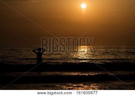 Woman On The Beautiful Beach At Sunrise