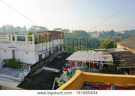 rooftop building with trees and bush photo taken in depok jakarta indonesia java