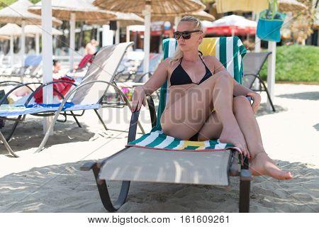 Woman Taking Sunbath Near Beach