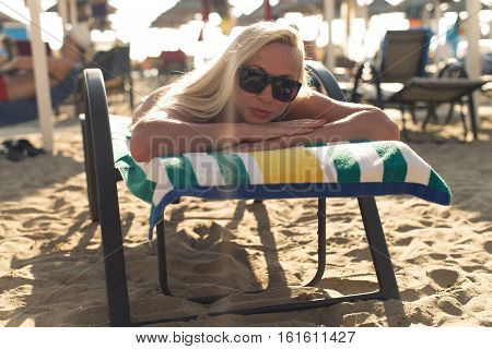 Portrait Of Alluring Woman Lying On The Chair