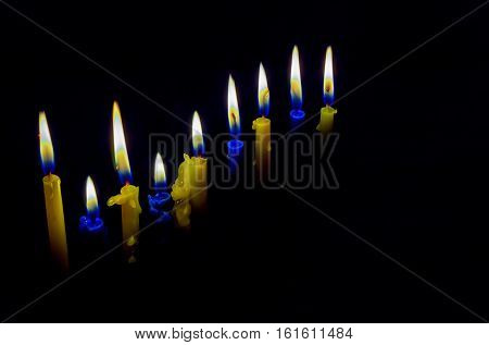 Jewish holiday hannukah low key image of jewish holiday Hanukkah with menorah traditional Candelabra and wooden dreidels spinning top . glitter overlay