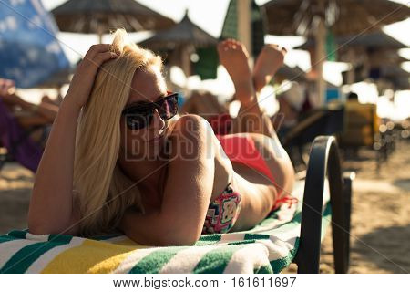 Attractive Woman Chilling In Chair At Sea Shore