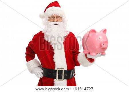 Santa claus with a piggybank isolated on white background