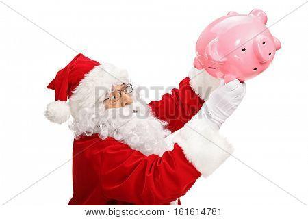 Santa claus shaking a piggybank isolated on white background
