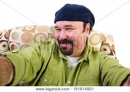 Smiling Overweight Man In Armchair Taking Selfie