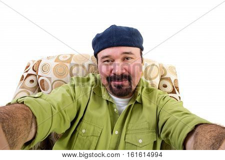 Man With Goatee In Armchair Taking Selfie