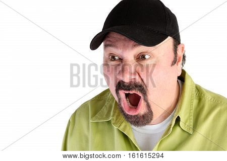 Portrait of horrified man in baseball cap shouting on white with copy space