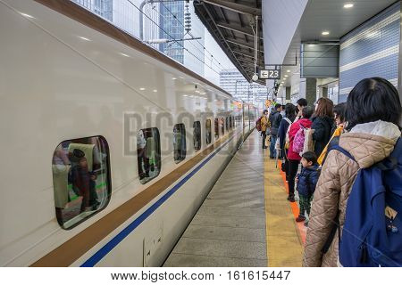 TOKYO  JAPAN - 20 NOV 16 : Passengers waiting for Shinkansen bullet train at Tokyo railway station on 20 Nov 2016, Shinkansen is world's busiest high-speed railway operated by four Japan Railways companies.