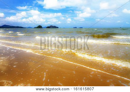 Wave and wind on golden sand at beach in Chumphon province Thailand.