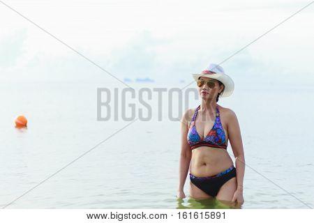 Bikini with women show sexy hat and sunglasses on Thung Wua Lan Beach at Chumphon Province Thailand