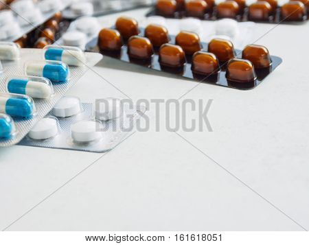 packing medicine pill and capsule on white background with copy space