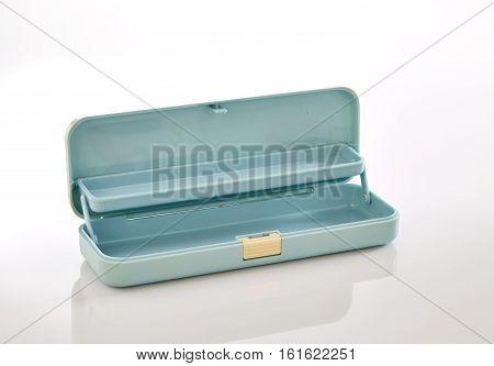 Light blue plastic pencil box on white background stack