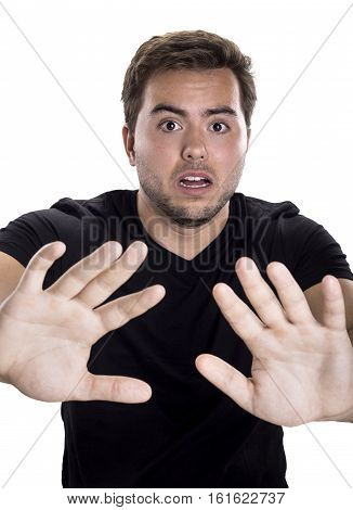 Man holding up hands as a stop gesture on a white background