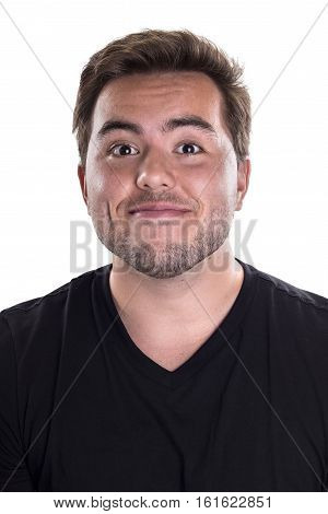 Portrait of a happy ecstatic male on a white background. He is portraying joy and confidence.