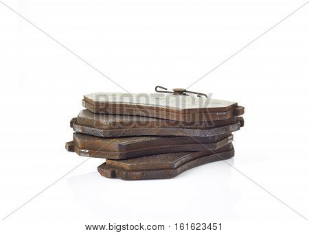 Old brake pads disk brake isolated on a white background