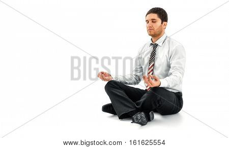 Zen businessman meditating in lotus pose with USA flag printed on a necktie