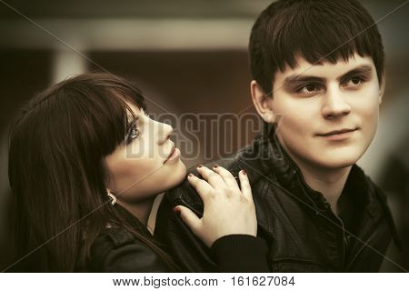 Happy young couple in love on city street. Stylish fashion model outdoor