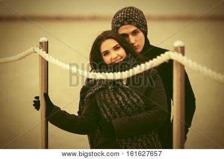 Happy young couple in love on the pier. Stylish fashion model outdoor