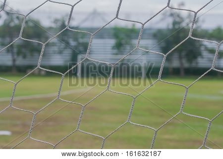 Close up soccer net goal with football goal background.