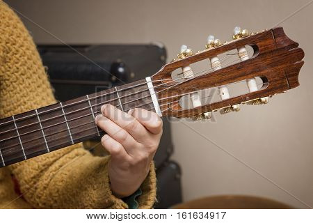 Close Up Shot Of A Hand Playing Classical Guitar