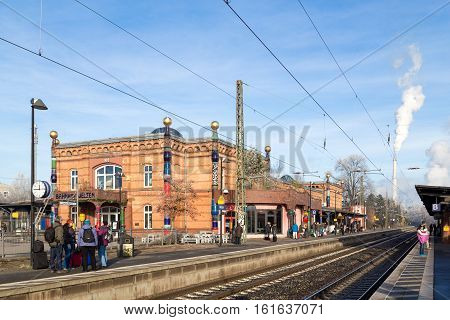 Uelzen, Germany - December 04, 2016: People waiting on the platform at the train station designed by Austrian artist Friedensreich Hundertwasser