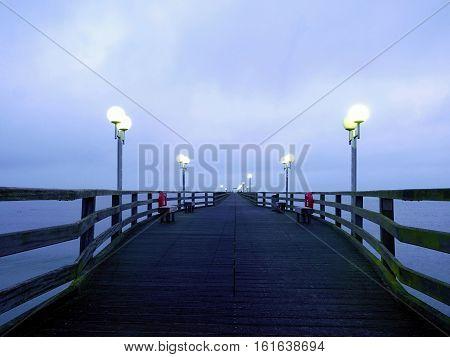 Autumn Dark Mist On Wooden Pier Above Sea. Depression, Dark Atmosphere.
