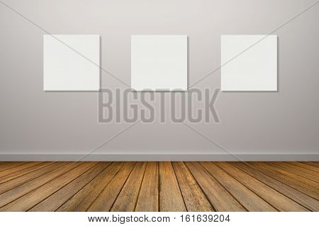 Three Frame Of White Poster Haning In Empty Room.space For Your Text And Picture.product Display Tem