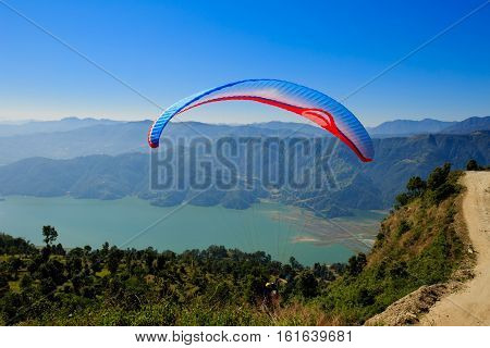 Pokhara Nepal - November 3rd 2016: View of a paraglider preparing to launch itself in the air.