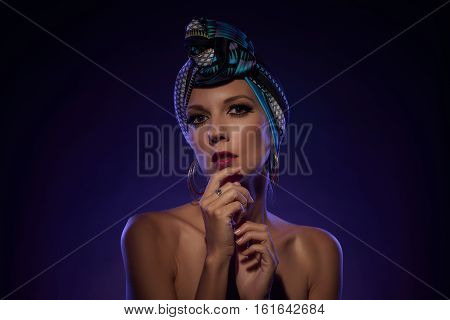 Portrait of attractive young woman wearing turban on her head