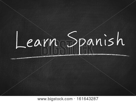 learn Spanish concept text on blackboard background