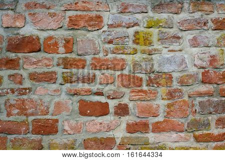 old red brick wall with plaster subsiding, overall view