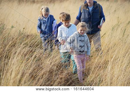 Teacher taking kids to countryside to explore nature