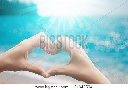 Female Hands Heart Shape On Nature Bokeh Sun Light Flare Wave And Blur Tropical Beach Abstract Backg