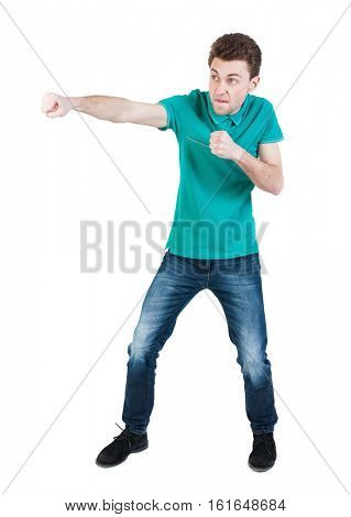 back view of skinny guy funny fights waving his arms and legs. Isolated over white background. Rear view people collection.  The guy in the green shirt waving fists.