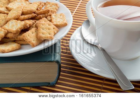 Close-up View On A Cup Of Tea And Crackers