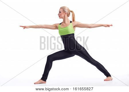Finding her inner peace. Beautiful female enjoying practicing yoga doing warrior asana isolated on white copyspace oga harmony peace health concept