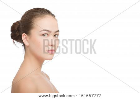 Woman with a natural beauty makeup look isolated over a white background with copyspace