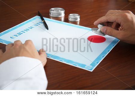 Notary public stamping certificate in office