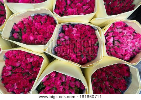 A bouquet of roses wrapped with paper for sale at Pak Khlong Talat Bangkok's largest flower market