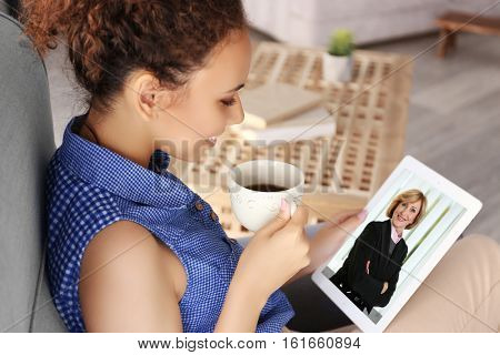 Woman video conferencing with lawyer on tablet. Video call and online service concept.